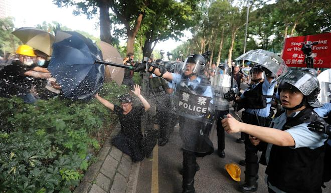 Protesters clash with police after the march in Sheung Shui ends. Photo: Felix Wong