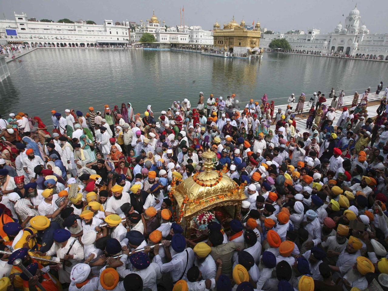 Sikh devotees carry their holy book Guru Granth Sahib in a palanquin during a religious procession inside the premises of the Golden Temple in the northern Indian city of Amritsar September 1, 2013. The procession was carried out to celebrate the 409th anniversary of the installation of the Guru Granth Sahib, the religious book of Sikhs. REUTERS/Munish Sharma (INDIA - Tags: RELIGION SOCIETY ANNIVERSARY)