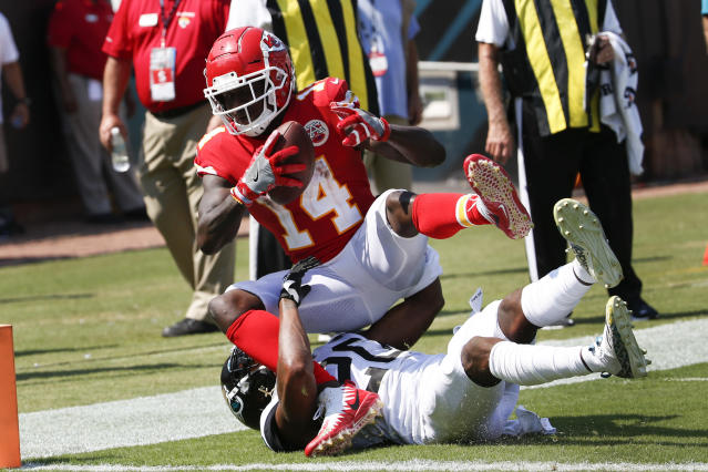 Kansas City Chiefs wide receiver Sammy Watkins (14) catches a 3-yard touchdown pass over Jacksonville Jaguars cornerback Jalen Ramsey during the second half of an NFL football game, Sunday, Sept. 8, 2019, in Jacksonville, Fla. (AP Photo/Stephen B. Morton)