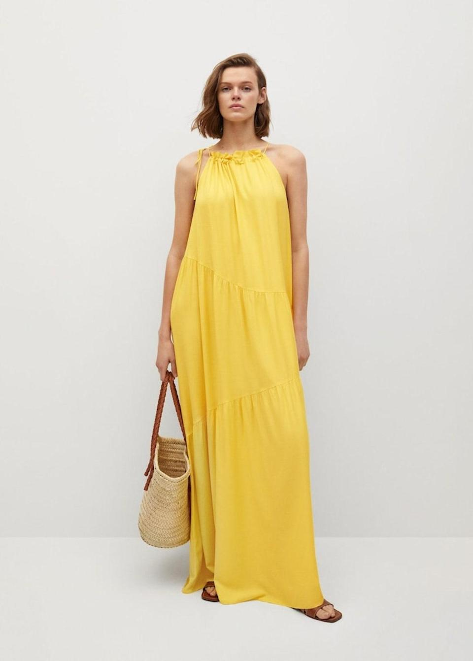 """Get your daily dose of vitamin C in with this sleeveless citrus dress, guaranteed to add zest to the evening's festivities. $80, Mango. <a href=""""https://shop.mango.com/us/women/dresses-and-jumpsuits-long/flowy-ruffled-dress_87039014.html"""" rel=""""nofollow noopener"""" target=""""_blank"""" data-ylk=""""slk:Get it now!"""" class=""""link rapid-noclick-resp"""">Get it now!</a>"""