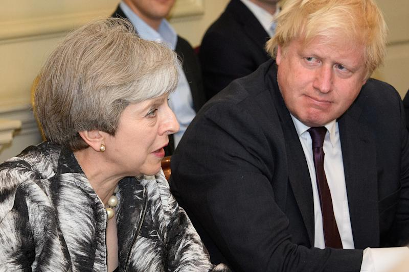 Britain's Prime Minister Theresa May sits next to Britain's Foreign Secretary Boris Johnson as she holds the first Cabinet meeting following the general election at 10 Downing Street, in London June 12, 2017. REUTERS/Leon Neal/Pool