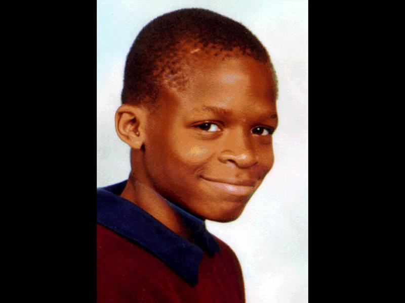 Damilola Taylor headshot, Nigerian boy murdered in London, Britain, photo on black
