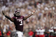 Texas A&M defensive lineman Tyree Johnson (3) reacts after sacking New Mexico quarterback Terry Wilson (2) during the first half of an NCAA college football game on Saturday, Sept. 18, 2021, in College Station, Texas. (AP Photo/Sam Craft)