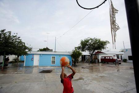 A Honduran migrant child plays with a ball at the Senda de Vida migrant shelter in Reynosa, in Tamaulipas state, Mexico June 22, 2018.  REUTERS/Daniel Becerril