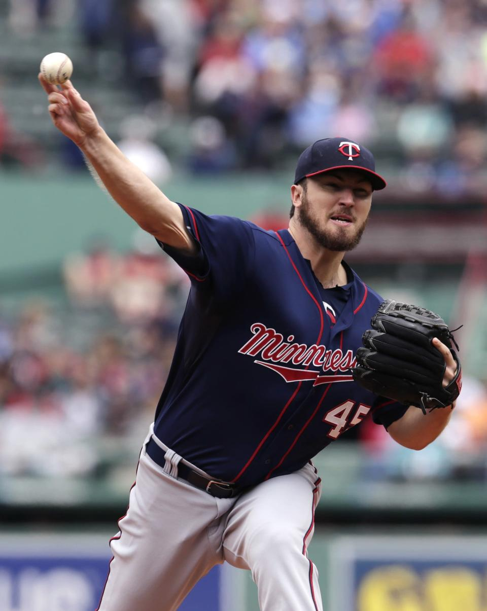 Minnesota Twins starting pitcher Phil Hughes delivers to the Boston Red Sox during the first inning in the first baseball game of a doubleheader at Fenway Park in Boston, Wednesday, June 3, 2015. (AP Photo/Charles Krupa)