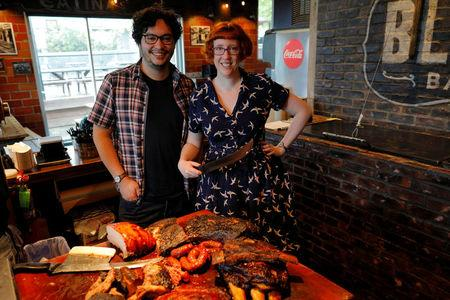 """Rose Tucker (L) and Matthew Salleh, directors of the documentary """"Barbecue,"""" pose for a portrait at Black's Barbecue restaurant during the South by Southwest (SXSW) Music Film Interactive Festival 2017 in Austin, Texas, U.S., March 11, 2017.   REUTERS/Brian Snyder"""