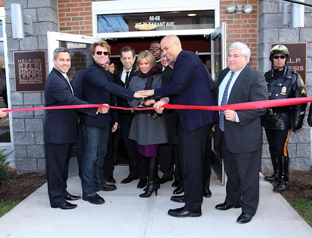 From left, North Ward councilman Anibal Ramos Jr., musician Jon Bon Jovi, designer Kenneth Cole, HELP USA Chairman Maria Cuomo Cole, Newark Mayor Cory Booker and HELP USA President Laurence Belinsky cut the ribbon at the opening of a Newark housing project funded through Bon Jovi's JBJ Soul Foundation, Dec. 8, 2009. (Photo: Mike Coppola/Getty Images)