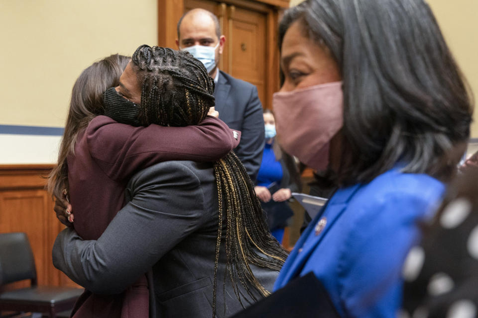 Rep. Alexandria Ocasio-Cortez, D-N.Y., left, hugs Rep. Cori Bush, D-Mo., after Bush testifed about her experience being raped and a subsequent abortion, Thursday, Sept. 30, 2021, during a House Committee on Oversight and Reform hearing on Capitol Hill in Washington. At right is Rep. Pramila Jayapal, D-Wash., who also testified about her decision to have an abortion. (AP Photo/Jacquelyn Martin)
