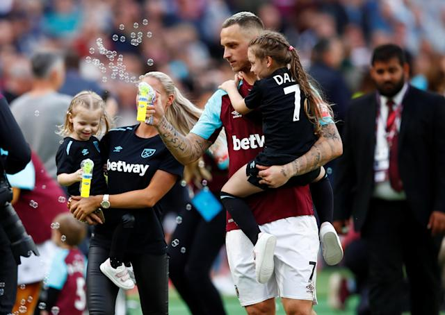 "Soccer Football - Premier League - West Ham United vs Everton - London Stadium, London, Britain - May 13, 2018 West Ham United's Marko Arnautovic with his family during a lap of honour after the match REUTERS/Eddie Keogh EDITORIAL USE ONLY. No use with unauthorized audio, video, data, fixture lists, club/league logos or ""live"" services. Online in-match use limited to 75 images, no video emulation. No use in betting, games or single club/league/player publications. Please contact your account representative for further details."