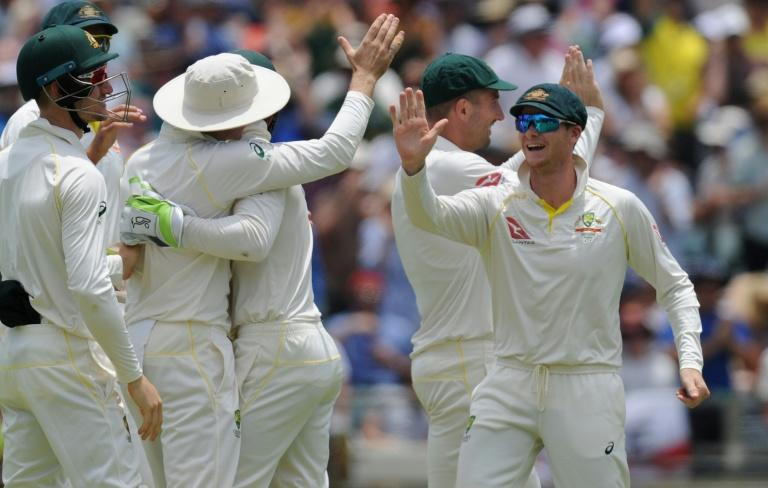 Australian players celebrate the dismissal of England's Dawid Malan on day two of their third Ashes Test match, in Perth, on December 15, 2017