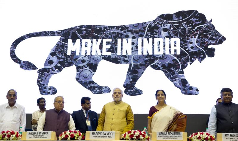 "FILE - In this Thursday, Sept. 25, 2014. file photo, Indian Prime Minister Narendra Modi, center, unveils the logo of 'Make in India' initiative in New Delhi, India. Modi and the BJP on Thursday, May 23, 2019, claimed a thunderous sweep of India's general elections, winning well over the 272 seats in the lower house of Parliament required to form a government. Modi described his first term in office as ""filling in potholes,"" shorthand for addressing the country's basic needs. In the next five years, he pledged in an April campaign speech, his Hindu nationalist Bharatiya Janata Party would ""try to address people's aspirations and take the country to new heights."" (AP Photo/Saurabh Das, File)"