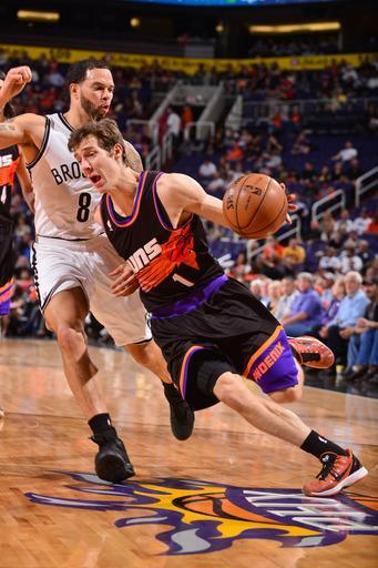 PHOENIX, AZ - MARCH 24: Goran Dragic #1 of the Phoenix Suns drives against Deron Williams #8 of the Brooklyn Nets on March 24, 2013 at U.S. Airways Center in Phoenix, Arizona. (Photo by Barry Gossage/NBAE via Getty Images)