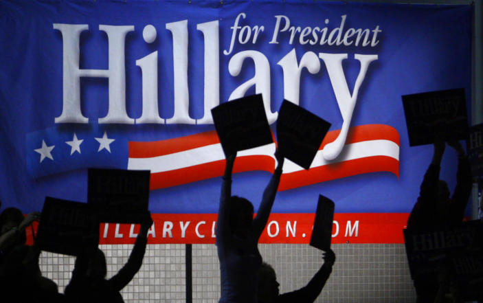 <p>Supporters of Democratic presidential candidate Sen. Hillary Clinton wave campaign signs at the Virginia Jefferson-Jackson Dinner in Richmond, Va., in February 2008. (Photo: Jim Young/Reuters)</p>