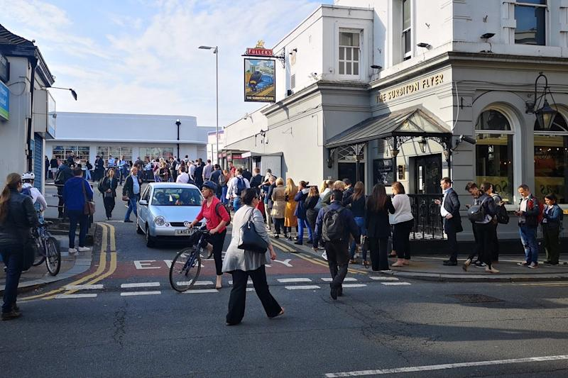 Queues form outside stations on first day of strike.(Evening Standard )