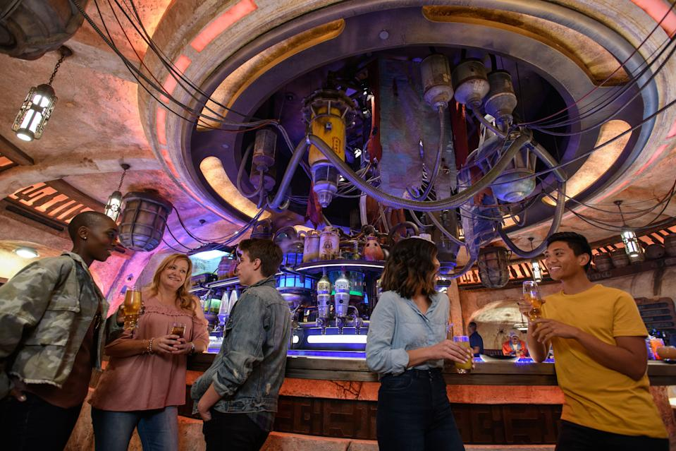 """Thirsty guests can visit Oga's Cantina, a watering hole run by Oga Garra, a local crime boss who keeps Sith and Jedi loyalists alike in line. Patrons of the cantina come from across the galaxy to sample the famous concoctions created with exotic ingredients using """"otherworldly"""" methods, served in unique vessels, with choices for guests of all ages. (Photo: Richard Harbaugh/Disney Parks)"""
