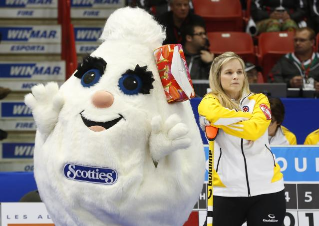 A curling mascot waves behind Manitoba skip Jennifer Jones during her gold medal game against Alberta during the Scotties Tournament of Hearts in Moose Jaw, Saskatchewan, February 22, 2015. REUTERS/Todd Korol (CANADA - Tags: SPORT CURLING)