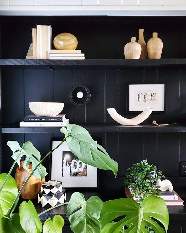 "<p>Dealing with a rich, dark color bookshelf or backdrop? Add books, vases, and objects in a lighter color, everything on the shelf will pop. Plus, interesting shapes and textures will get more attention. </p><p><a href=""https://www.instagram.com/p/CAeGYk_BHFf/"" rel=""nofollow noopener"" target=""_blank"" data-ylk=""slk:See the original post on Instagram"" class=""link rapid-noclick-resp"">See the original post on Instagram</a></p>"