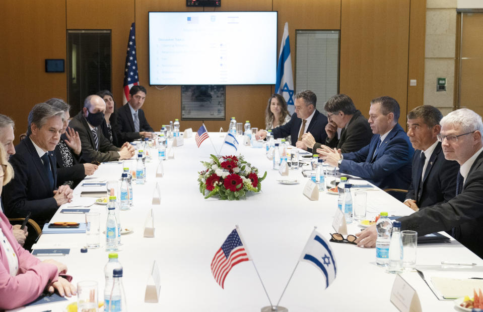 Secretary of State Antony Blinken is seated with Israeli Foreign Minister Gabi Ashkenazi, second from right, before their meeting at the Ministry of Foreign Affairs, Tuesday, May 25, 2021, in Jerusalem, Israel. (AP Photo/Alex Brandon, Pool)