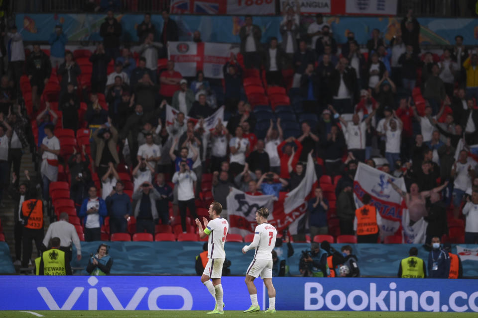 England's Harry Kane and Jack Grealish, right, applaud fans at the end of the Euro 2020 soccer championship group D match between Czech Republic and England, at Wembley stadium in London, Tuesday, June 22, 2021. England won 1-0. (AP Photo/Laurence Griffiths, Pool)