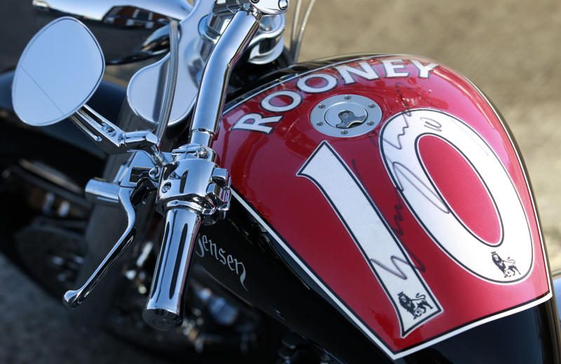 The motorbike, customised by Wayne Rooney, fetched £43,250 at a charity auction (PA)