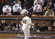 FILE - In this Oct. 25, 2014, file photo, San Francisco Giants' Pablo Sandoval walks past fans wearing panda heads after striking out during the third inning of Game 4 of baseball's World Series against the Kansas City Royals in San Francisco. Sandoval and the Boston Red Sox have agreed to a multiyear contract, a person with knowledge of the deal said. The person spoke to The Associated Press on condition of anonymity Monday, Nov. 24, 2014, because the Red Sox had not announced the agreement. (AP Photo/Charlie Riedel, File)