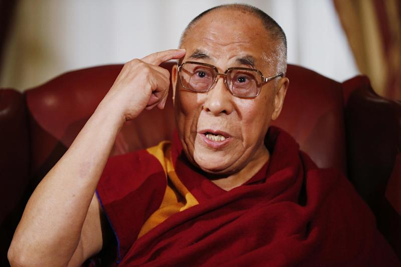 Tibetan spiritual leader the Dalai Lama makes a statement to reporters as he meets with House Speaker John Boehner of Ohio and House Minority Leader Nancy Pelosi of Calif., on Capitol Hill in Washington, Thursday, March 6, 2014. (AP Photo/Charles Dharapak)