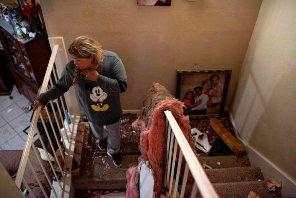 PHOTO: Maria Hernandez looks through her damaged home after an explosion at a northwest Houston, Texas manufacturing business, on Jan. 24, 2020. (Mark Felix/AFP /AFP via Getty Images)