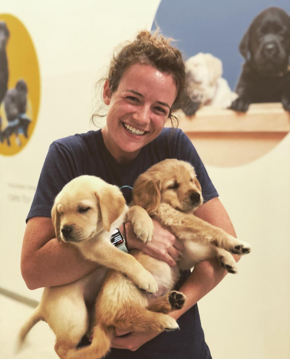 Researcher Emily Bray with two of her subjects (Canine Companions for Independence/PA)