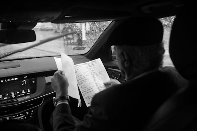 <p>Spencer Leak Sr consults a schedule while en route to a funeral on Chicago's south side. Though most services are held on Saturdays, he has started to schedule services on Sundays to meet demand from families seeking to bury loved ones killed in Chicago's uptick of violence. (Photo: Jon Lowenstein/NOOR for Yahoo News) </p>