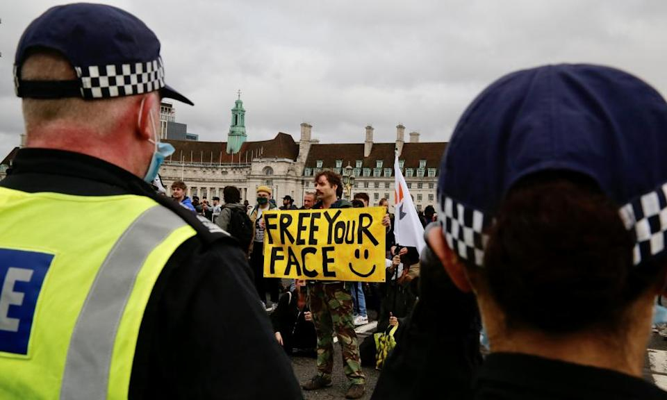 Protesters confront police in London