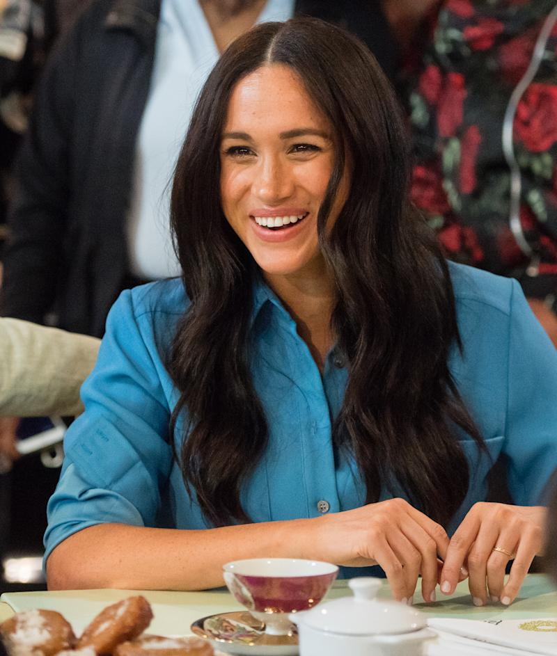 Meghan Markle laughs on royal tour in Africa
