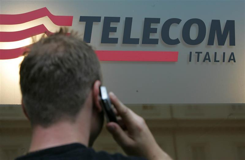 Man uses mobile phone in front of Telecom Italia shop in downtown Rome