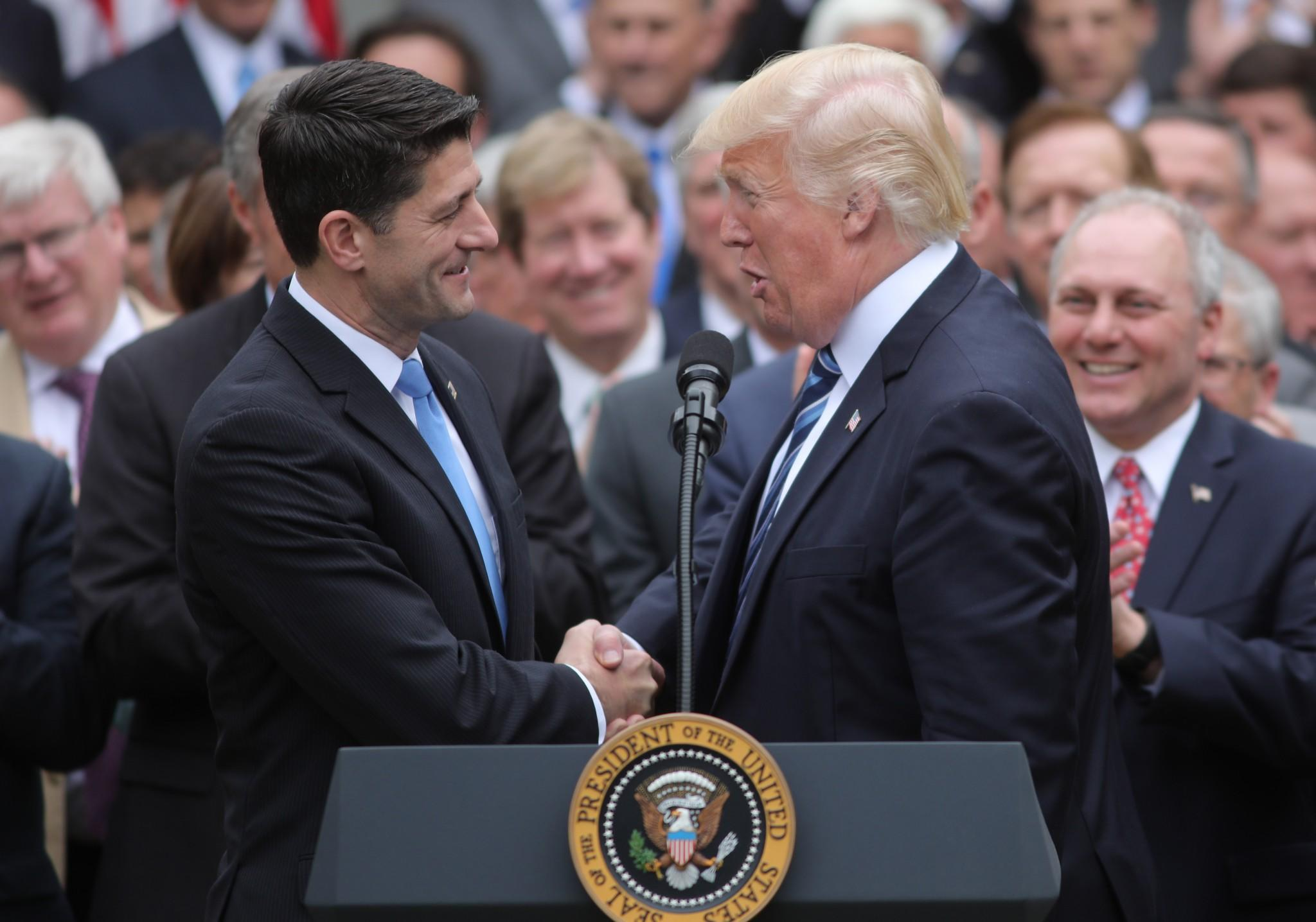 U.S. President Donald Trump congratulates House Speaker Paul Ryan (L) as he gathers with Congressional Republicans in the Rose Garden of the White House after the House of Representatives approved the American Healthcare Act, to repeal major parts of Obamacare and replace it with the Republican healthcare plan, in Washington, U.S., May 4, 2017. (Photo: Carlos Barria/Reuters)