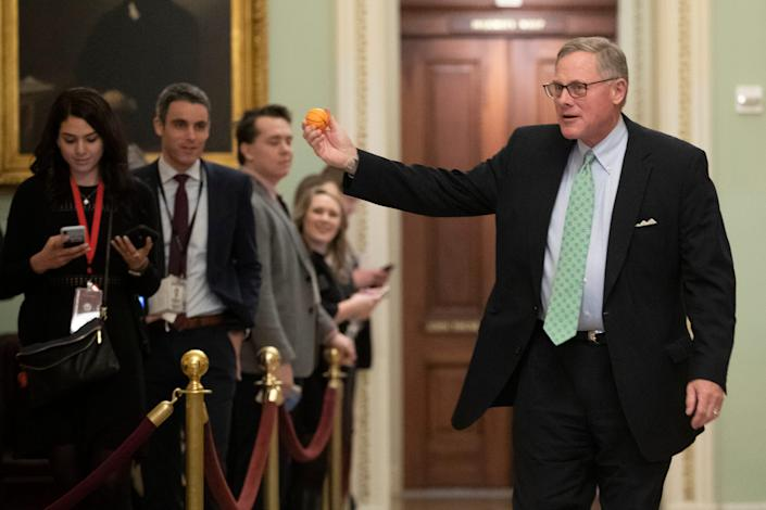 Sen. Richard Burr R-NC., displays a stress ball as he walks to the Senate Chamber prior to the start of the impeachment trial of President Donald Trump at the U.S. Capitol, Thursday, Jan. 23, 2020, in Washington. (AP Photo/Steve Helber)