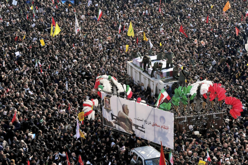 Coffins of Gen. Qassem Soleimani and others who were killed in Iraq by a U.S. drone strike are carried on a truck surrounded by mourners during a funeral procession, at the Enqelab-e-Eslami (Islamic Revolution) square in Tehran, Iran, Monday, Jan. 6, 2020. The processions mark the first time Iran honored a single man with a multi-city ceremony. Not even Ayatollah Ruhollah Khomeini, who founded the Islamic Republic, received such a processional with his death in 1989. Soleimani on Monday will lie in state at Tehran's famed Musalla mosque as the revolutionary leader did before him. (AP Photo/Ebrahim Noroozi)