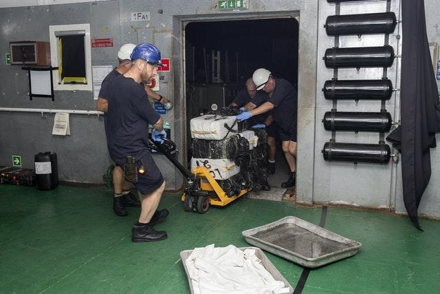 Suspected drugs being loaded onto support ship RFA Argus in the Caribbean Sea