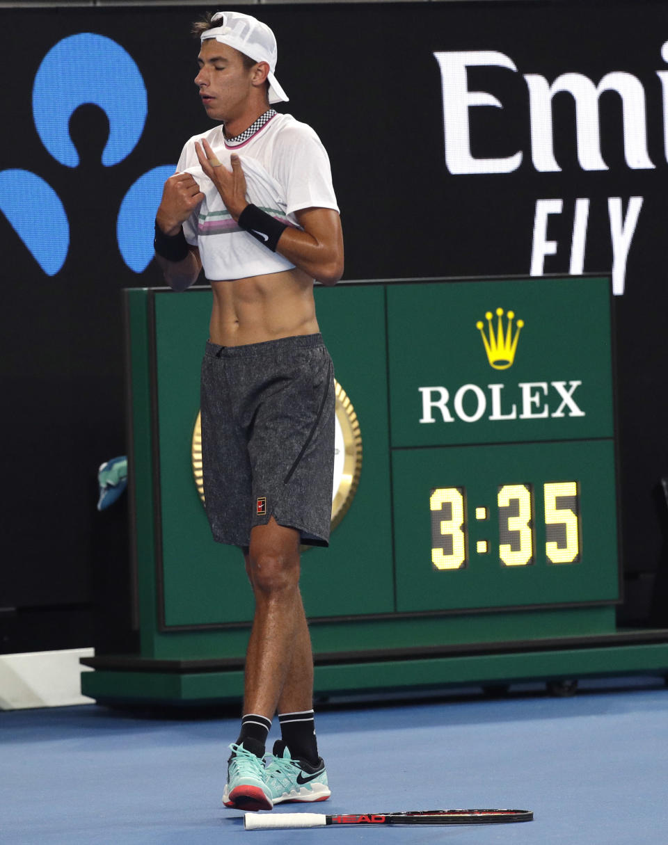 Australia's Alexei Popyrin reacts after losing a point to France's Lucas Pouille during their third round match at the Australian Open tennis championships in Melbourne, Australia, Sunday, Jan. 20, 2019. (AP Photo/Kin Cheung)