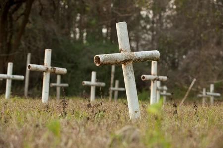 FILE PHOTO: White metal crosses mark graves at the cemetery of the former Arthur G. Dozier School for Boys in Marianna