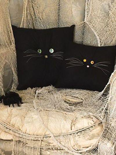 """<p>You can spruce up your home for the Halloween season with these adorable black kitty pillows complete with whiskers. </p><p><em><a href=""""https://www.womansday.com/home/crafts-projects/how-to/a3063/halloween-crafts-black-cat-pillows-21977/"""" rel=""""nofollow noopener"""" target=""""_blank"""" data-ylk=""""slk:Get the tutorial for Black Cat Pillows."""" class=""""link rapid-noclick-resp"""">Get the tutorial for Black Cat Pillows.</a></em></p>"""