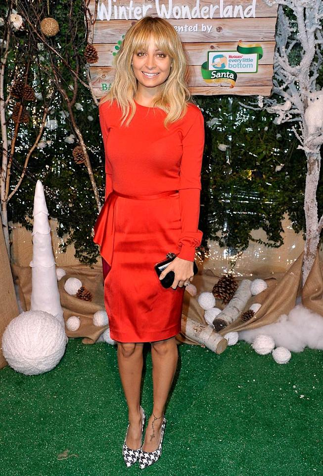 Back in L.A., Nicole Richie was all smiles upon arriving at the Baby2Baby Winter Wonderland soiree in a Stella McCartney ensemble. The House of Harlow creator paired her red, long-sleeved blouse and satin skirt with trendy Salvatore Ferragamo houndstooth pumps and a simple clutch. (11/12/2011)