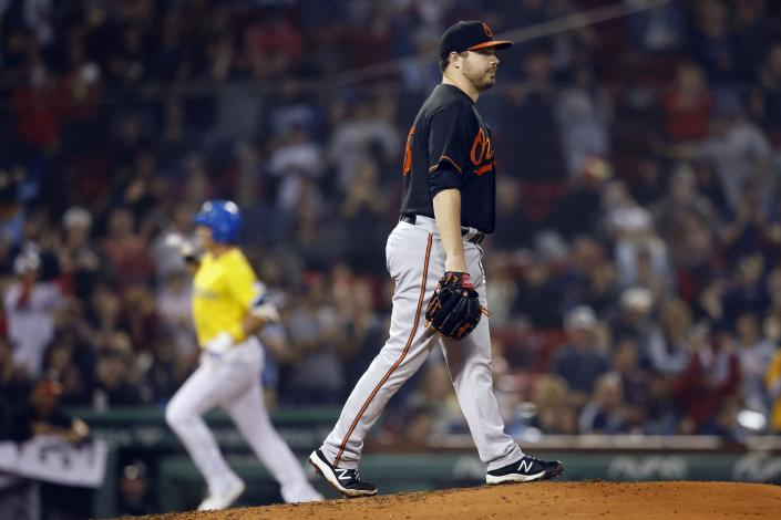 Baltimore Orioles' Keegan Akin walks on the mound after giving up a solo home run to Boston Red Sox's Bobby Dalbec, left, during the fourth inning of a baseball game Friday, Sept. 17, 2021, in Boston. (AP Photo/Michael Dwyer)