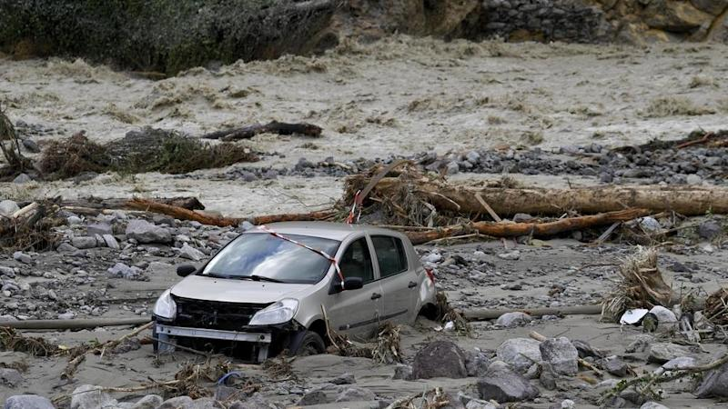 Two dead, number of missing grows, after storms lash France-Italy border