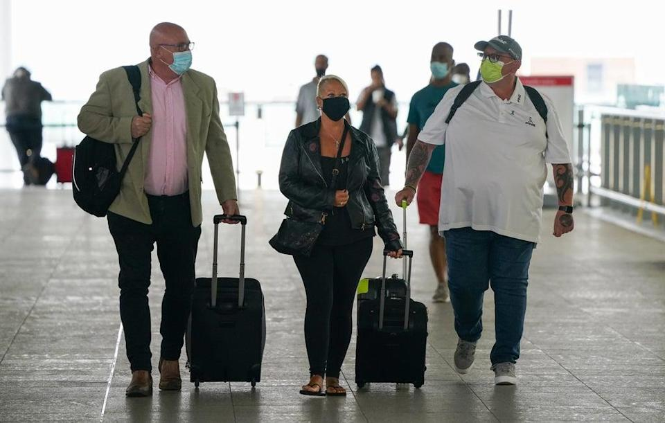 Charlotte Charles and Tim Dunn, the parents of Harry Dunn, with family adviser Radd Seiger (Andrew Matthews/PA) (PA Wire)