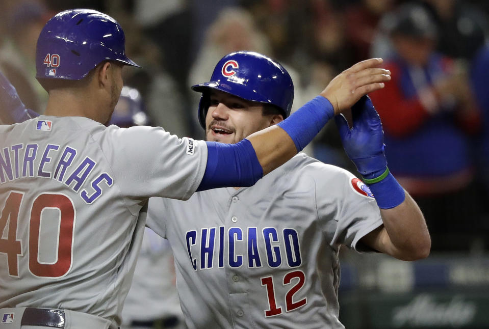 Chicago Cubs' Kyle Schwarber (12) is congratulated by Willson Contreras after Schwarber's two-run home run against the Seattle Mariners during the eighth inning of a baseball game Tuesday, April 30, 2019, in Seattle. (AP Photo/Elaine Thompson)