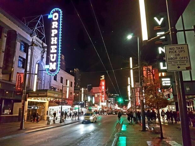 Club-goers walk down Vancouver's Granville Street on Dec. 1, 2018. Nightclubs and bars are welcoming patrons back since the province entered the third phase of its reopening plan on July 1.  (Roshini Nair/CBC - image credit)