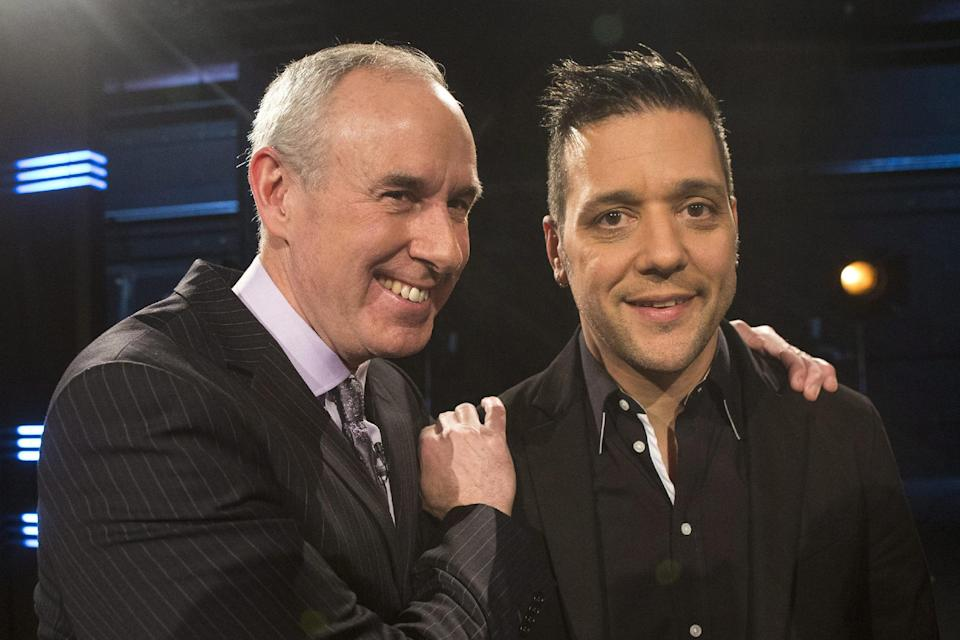 George Stroumboulopoulos, right, is pictured with Ron MacLean as Rogers TV unveil their team for the station's NHL coverage in Toronto on Monday March 10, 2014. (AP Photo/The Canadian Press, Chris Young)