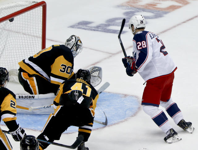 Columbus Blue Jackets' Oliver Bjorkstrand (28) scores on Pittsburgh Penguins goaltender Matt Murray for his third goal of the game during the third period of an NHL preseason hockey game, Saturday, Sept. 22, 2018, in Pittsburgh. The Penguins won 7-3. (AP Photo/Keith Srakocic)