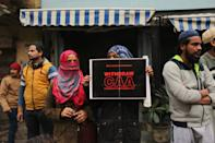 Protesters with posters and placards during a demonstration against the Citizenship Amendment Act (CAA) and National Register of Citizens (NRC) near Red fort on December 19, 2019 in New Delhi, India. Around 1200 protesters including Swaraj India chief Yogendra Yadav and student leader Umar Khalid were detained by Delhi Police during the protest rally at Redfort. The protests have spiked since Sunday following the crackdown and violent police action on students in Jamia Millia Islamia university and Aligarh Muslim University. (Photo by Mayank Makhija/NurPhoto via Getty Images)