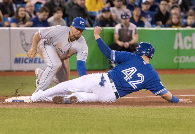 Kansas City Royals third baseman Cheslor Cuthbert puts the tag on Toronto Blue Jays' Justin Smoak for the out at third base in the sixth inning in the first game of their baseball doubleheader in Toronto on Tuesday April 17, 2018. Fred Thornhill/The Canadian Press via AP)