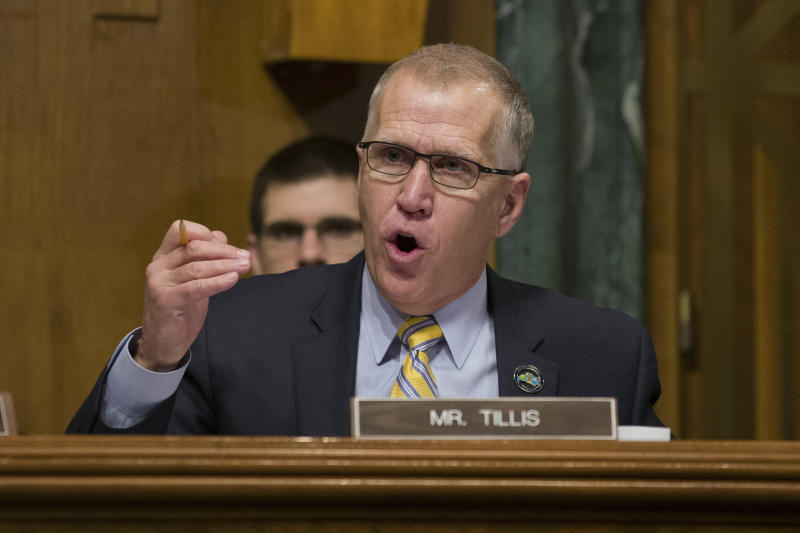 In this March 6, 2019, photo, Sen. Thom Tillis, R-N.C., questions U.S. Customs and Border Protection Commissioner Kevin McAleenan during a hearing of the Senate Judiciary Committee on oversight of Customs and Border Protection's response to the smuggling of persons at the southern border in Washington. Republicans from the White House to Congress to North Carolina are watching whether Tillis stands with Trump. (AP Photo/Alex Brandon)